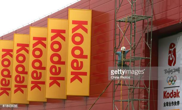 A worker builds an exhibit area of Olympic sponsor Kodak at the Olympic Green area on July 7 2008 in Beijing China Beijing's Olympic Green is the...