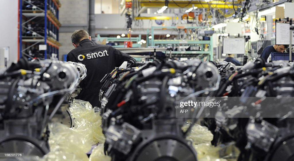A worker builds Smart ForTwo motors at the Smart car factory of Hambach, eastern France, on December 11, 2012. The third-generation Smart electric drive is scheduled to be launched in the U.S. and Europe by the second quarter of 2013 and Smart plans to mass produce the electric car with availability in 30 markets worldwide. VERHAEGEN