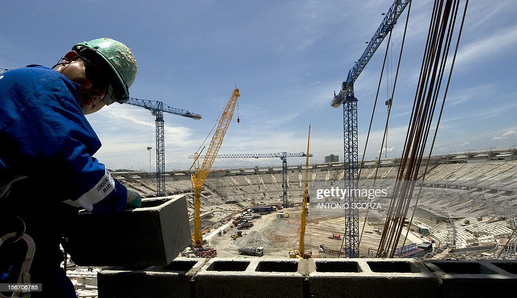 A worker can be seen placing concrete blocks at Maracana stadium during a tour for journalists organized by the Rio 2016 Committee on November 19, 2012 in Rio De Janeiro, Brazil.