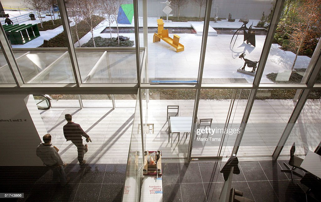 A worker carries a drill in front of the Sculpture Garden in the newly remodeled Museum of Modern Art during a media preview November 15 2004 in New...