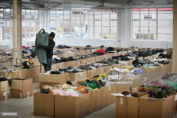 A worker carries a manequin at Angels Costumiers vintage clothing sale in a warehouse in Wembley on November 28 2008 in London Over 30000 items of...