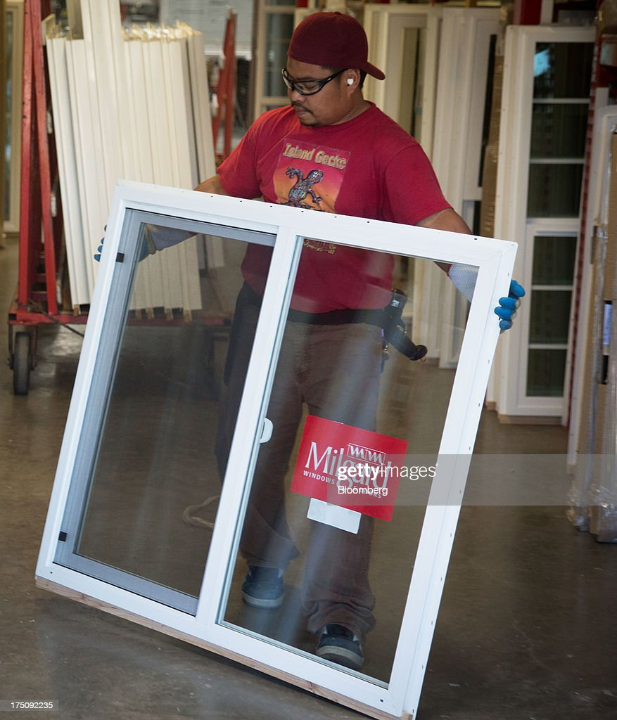 A worker carries a vinyl replacement window for delivery at the Milgard Windows & Doors' manufacturing facility in Tacoma, Washington, U.S., on Wednesday, July 24, 2013. The U.S. Census Bureau is scheduled to release monthly factory orders figures on Aug. 2. Photographer: Tim Rue/Bloomberg via Getty Images