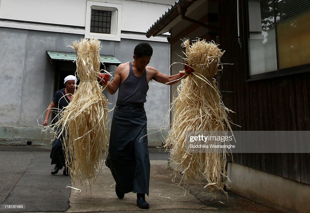 A worker carries bundles of mulberry tree wood at a mill that produces handmade paper at Iwano Heizaburo Seishi Sho Company in Echizen paper village on July 4, 2011 in Fukui, Japan. Washi paper is a tough paper, used for traditional Japanese arts such as Origami and Shodo, most commonly made from bark of the mulberry, gampi or mitsumata. The paper milling process is a traditional craft of the Echizen people dating back 1500 years which continues today along with modern paper manufacturing. Echizen city is home to many paper businesses, as well as the cultural museum of paper and papyrus centre where visitors can make their own paper.