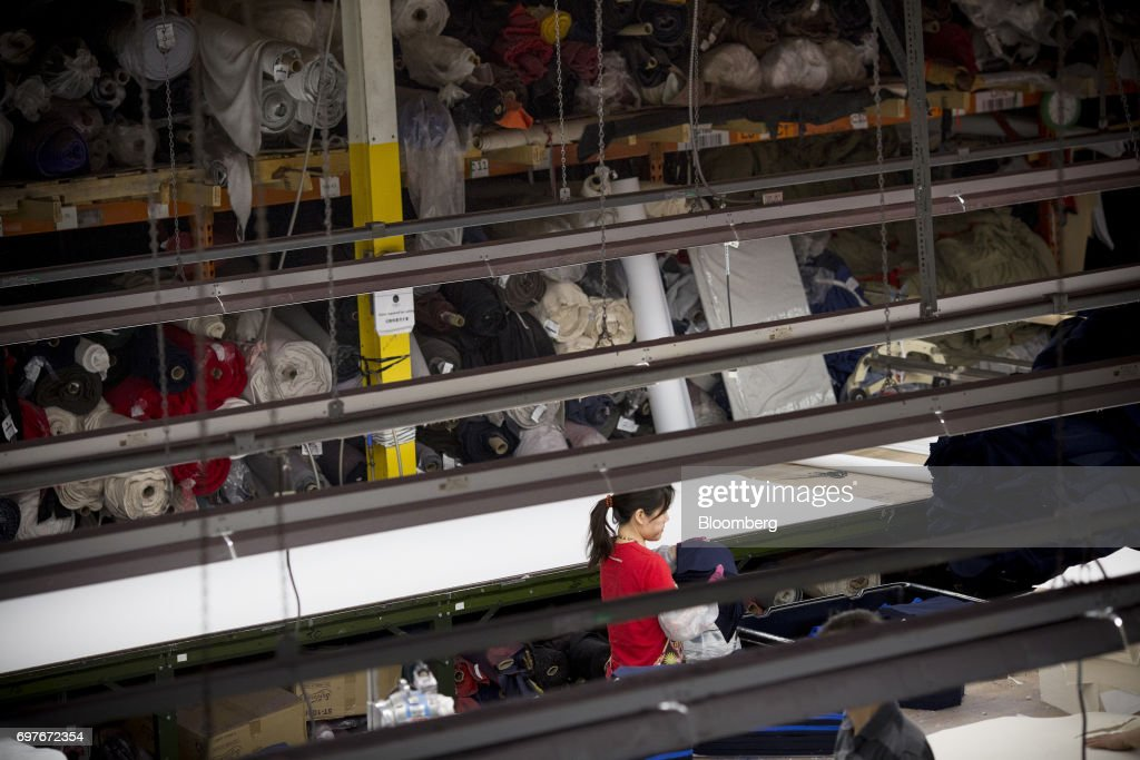 A worker carries fabric at the WS & Co. production facility in Toronto, Ontario, Canada, on Friday, June 9, 2017. Canada Day celebrates the anniversary of the creation of the Canadian Federation through the North America Act on July 1. Photographer: Brent Lewin/Bloomberg via Getty Images