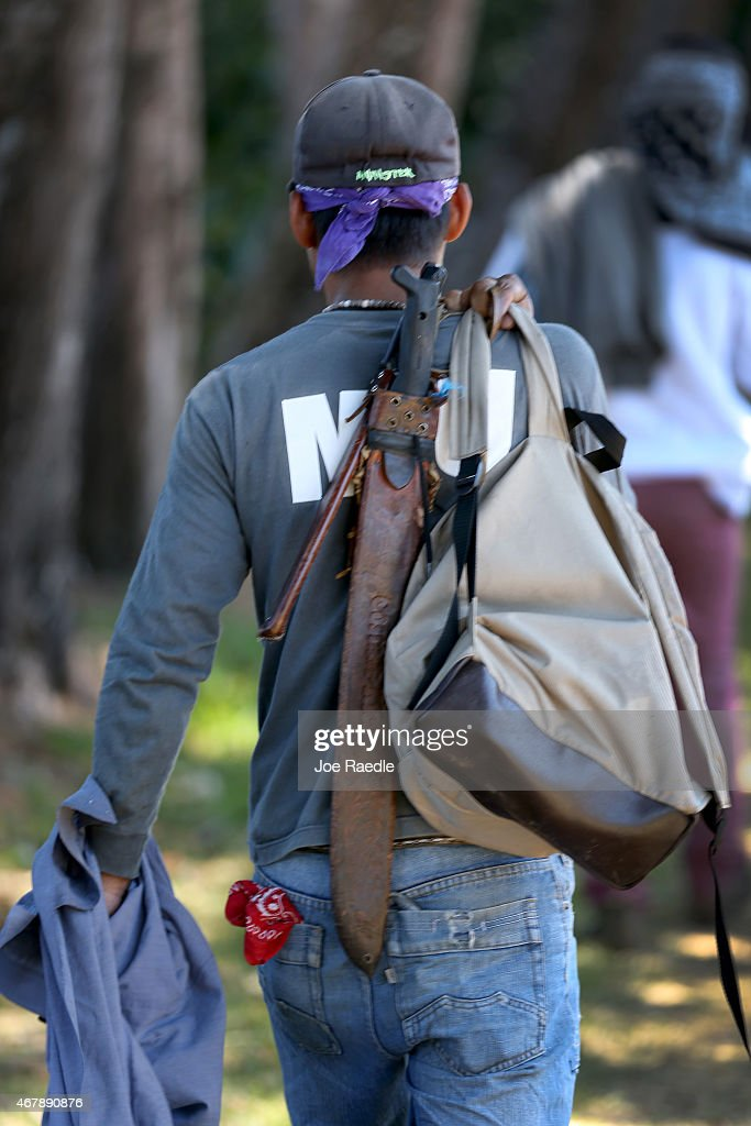 A worker carries his machete as he tends to the coffee plants at the Doka Estate coffee farm on March 25 2015 in Alajuela Costa Rica The farm is one...