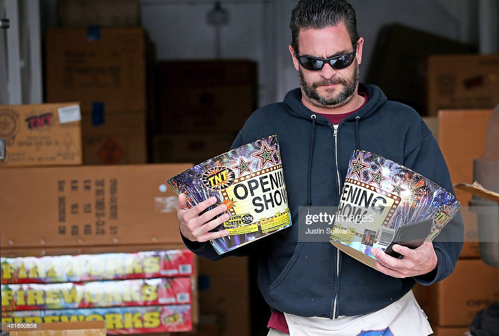 A worker carries 'Opening Show' fireworks at the Camp St. Andrews fireworks stand on July 3, 2014 in San Bruno, California. As California's historic drought continues and fire danger is at severe levels, fire departments in the greater San Francisco Bay Area are on heightened alert as vendors in select cities in Santa Clara, San Mateo and Alameda counties sell fireworks ahead of the Fourth of July holiday.