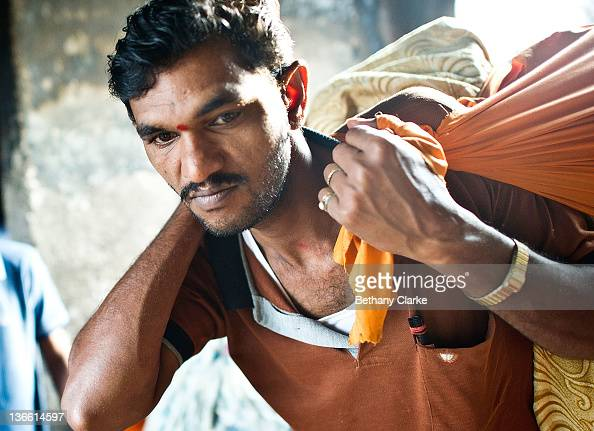 A worker carries washings at Dhobi Ghat on November 4 2011 in Mumbai India Dhobi Ghat is known as the world's largest laundryDhobi Ghat has 800 wash...