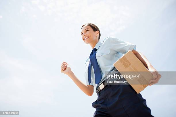 Worker carrying box