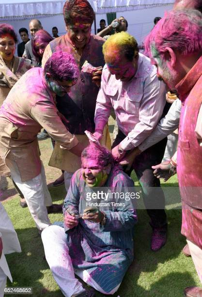 BJP worker celebrating Holi Milan part of Holi Festival at Delhi BJP Office and celebrate party landslide victory in assembly elections on March 12...