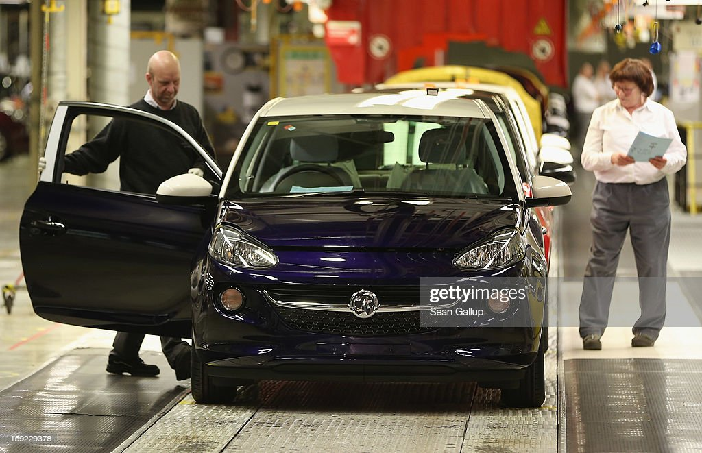 Worker check a finished Opel Adam car with Vauxhall branding at the assembly line shortly after a celebration to mark the launch of the new Opel compact car at the Opel factory on January 10, 2013 in Eisenach, Germany. Opel employees hope the car will help the compny return to profits after years of sagging sales and the announcement of the Bochum factory closure in 2016.