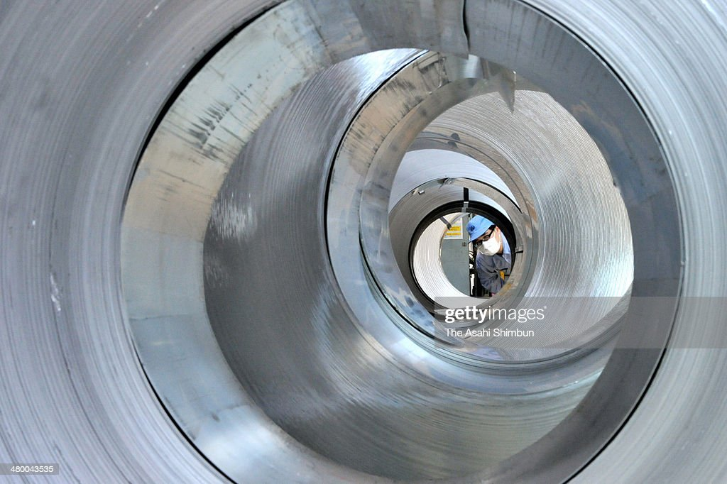 A worker check the aluminium sheets to produce one Japanese yen coins as demands for the coins could be raised after the consumption tax hike on February 28, 2014 in Tokyo, Japan. Japan raises consumption tax from 5 to 8 percent on April 1, and possibly to 10 percent in October 2015, despite market concerns about a slowing of the economic recovery.