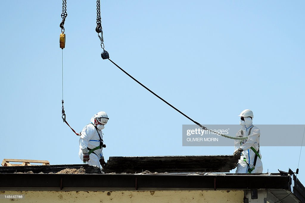 Worker check the damages on the roof of the warehouse of Modena's balsamic vinegar producer Giancarlo Pontiroli after an earthquake on May 30, 2012 in Mirandola. The strong quake which struck Italy on Tuesday, killing 15 and destroying buildings, has also dealt a blow to Modena's balsamic vinegar industry -- days after a quake in the area hit Parmesan production.