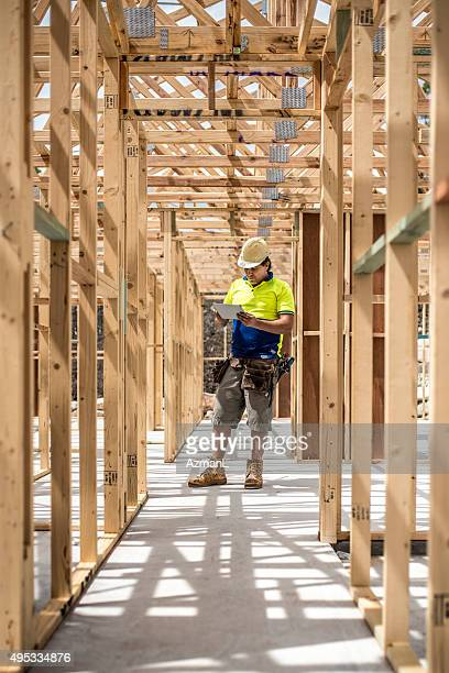 Worker Checking Construction Site