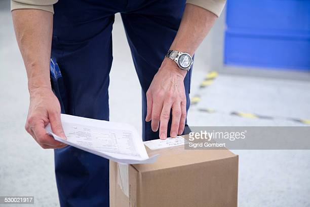 Worker checking packaging at healthcare warehouse