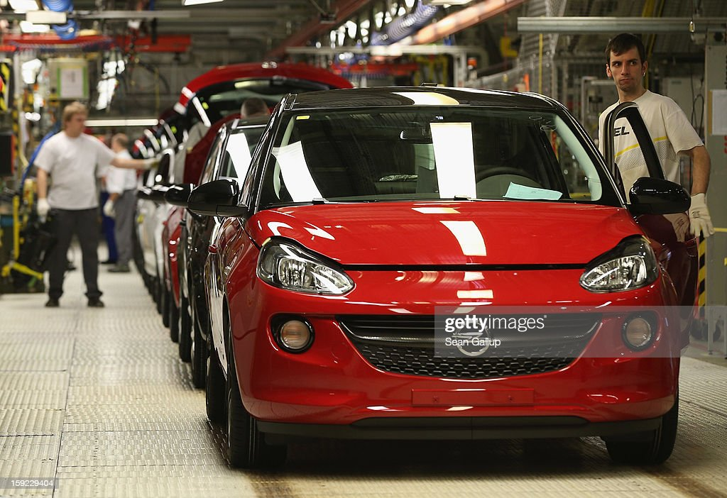 A worker checks a finished Opel Adam car at the assembly line shortly after a celebration to mark the launch of the new Opel compact car at the Opel...