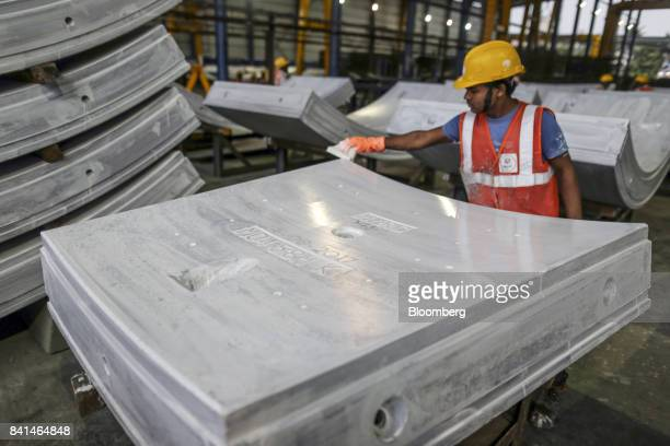 A worker checks a precast concrete tunnel segments sit at the Mumbai Metro Rail Corp casting yard in Mumbai India on Monday Aug 28 2017 The expanding...