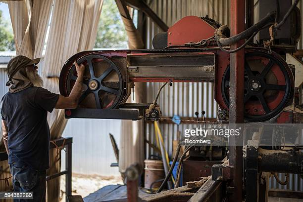 A worker checks a saw blade at the Spotted Owl Timber Inc mill in Santa Fe New Mexico US on Monday Aug 15 2016 Founded in 1991 the family owned and...