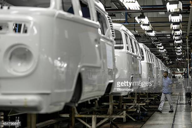 A worker checks a Volkswagen AG camper van or microbus known as a 'Kombi' in Brazil on the assembly line at Volkswagen's Anchieta plant in Sao...