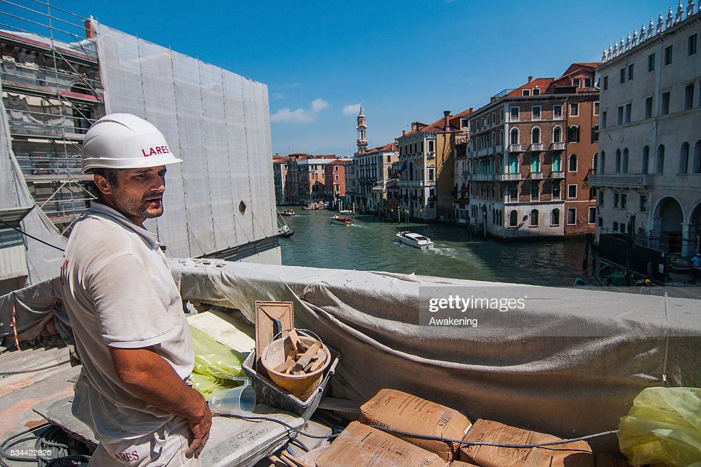 A worker checks all the materials during the renovation of the Rialto Bridge on May 26, 2016 in Venice, Italy. Site visits were organized to see the renovation of the Rialto bridge to coincide with the 15th Biennale of Architecture in Venice.