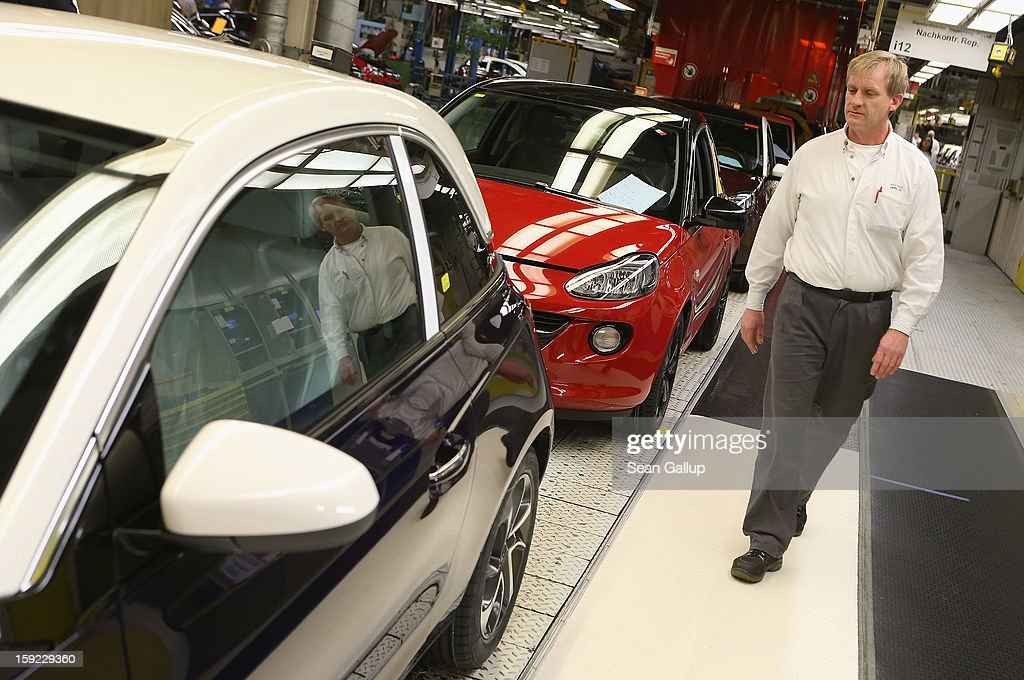 A worker checks finished Opel Adam cars at the assembly line shortly after a celebration to mark the launch of the new Opel compact car at the Opel factory on January 10, 2013 in Eisenach, Germany. Opel employees hope the car will help the compny return to profits after years of sagging sales and the announcement of the Bochum factory closure in 2016.