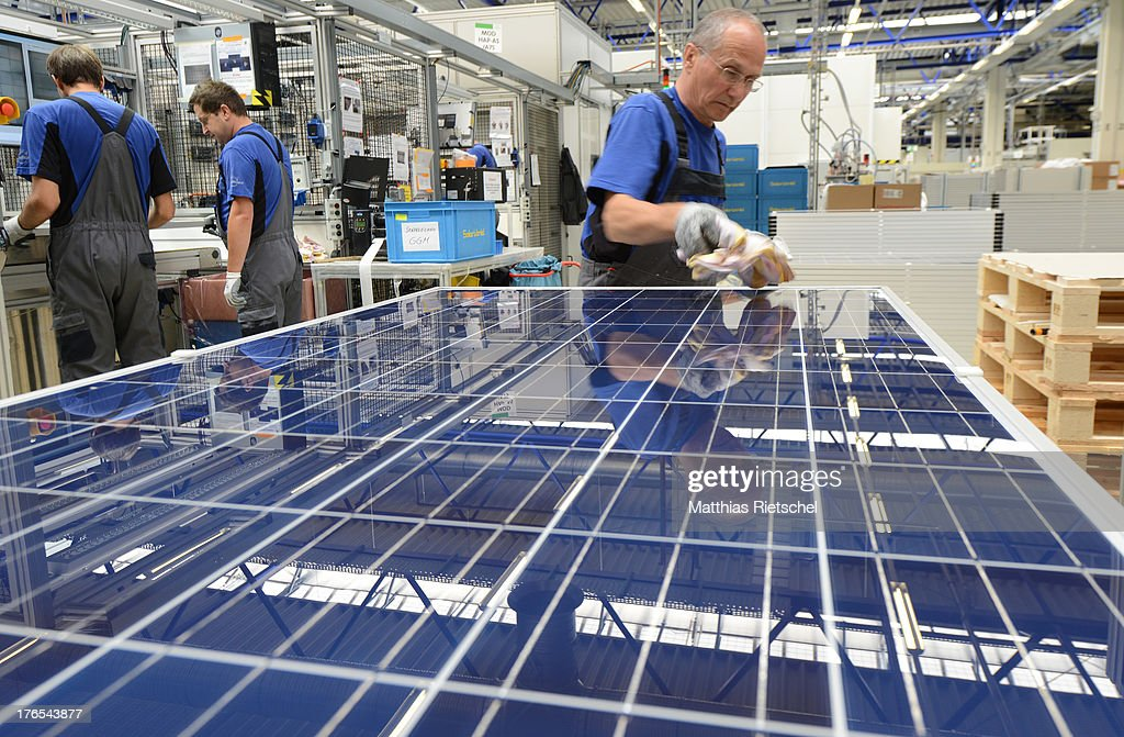A worker checks finished solar energy moduls at the Solarworld plant on August 14, 2013 in Freiberg, Germany. The troubled solar cells, modules and panels producer managed to recently avoid bankruptcy by reaching an agreement with its shareholders and other investors. Many solar energy equipment producers in Germany are facing difficult times due to stiff competition from China.