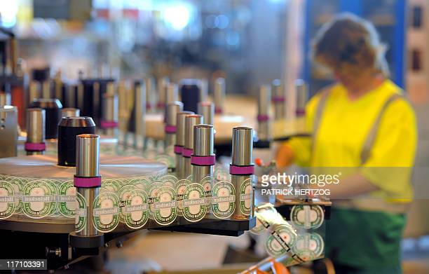 A worker checks labelling of bottles of beer at the production line of Dutch brewer Heineken factory on June 7 2011 in Schiltigheim eastern France...