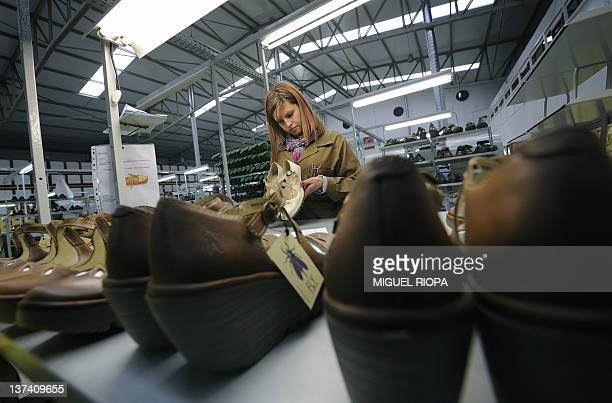 A worker checks shoes at a footwear factory of the Kyaia Group near Guimaraes northern Portugal on January 13 2012 The footwear industry in Portugal...