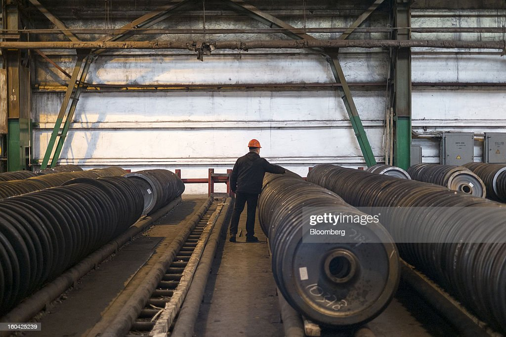 A worker checks steel wheels for railway rolling stock stacked before shipping at the Interpipe LLC steel plant in Dnipropetrovsk, Ukraine, on Wednesday, Jan. 30, 2013. Ukraine's Interpipe Group, owned by billionaire Victor Pinchuk, opened a $700 million electric steel mill in Dnipropetrovsk with an annual output capacity of 1.32 million tons of steel for its seamless pipe production. Photographer: Vincent Mundy/Bloomberg via Getty Images