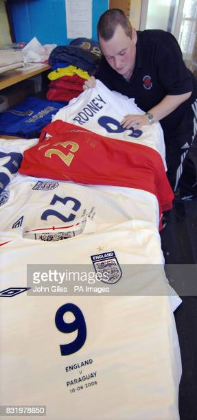 A worker checks the England team's World Cup kit the first batch of which was being collected today by the FA from International Sports Services in...
