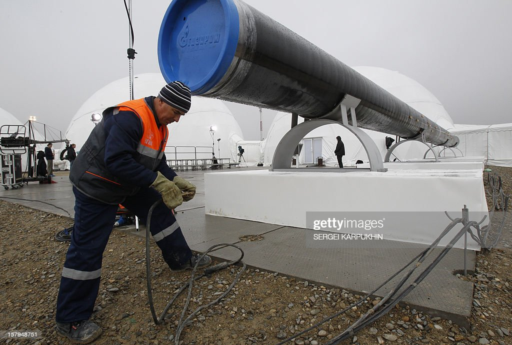A worker checks wires in front a gas pipe line section before a ceremony to launch the construction of South Stream gas pipeline outside the Black Sea resort town of Anapa, on December 7, 2012. Russia's President Vladimir Putin launched yesterday construction of the long-awaited South Stream pipeline that the Kremlin hopes will pump Russia's gas to Europe while avoiding its unpredictable neighbour Ukraine.