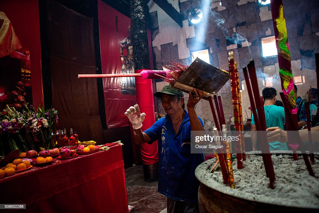 worker clean up the incense during Chinese New Year celebrations at Dharma Bhakti Temple on February 8, 2016 in Jakarta, Indonesia. The Chinese Lunar New Year also known as the Spring Festival, which is based on the Lunisolar Chinese calendar, is celebrated from the first day of the first month of the lunar year and ends with Lantern Festival on the fifteenth day.