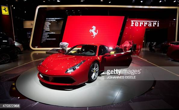 A worker cleans a Ferrari ahead of the 16th Shanghai International Automobile Industry Exhibition in Shanghai on April 19 2015 China is crucial to...