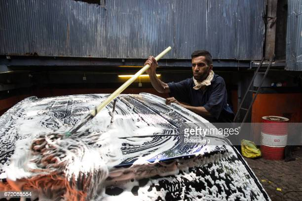A worker cleans a vehicle at a carwash in Colombo Sri Lanka on Thursday April 20 2017 The Central Bank of Sri Lanka is scheduled to announce its key...