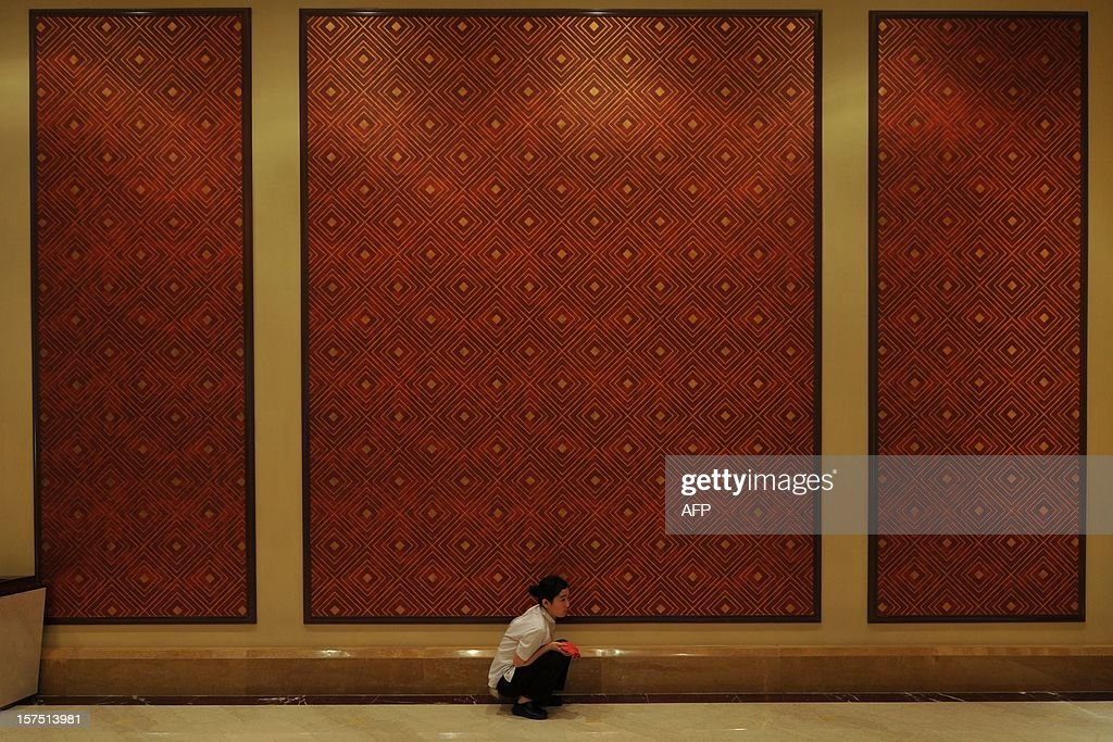 A worker cleans a wall inside the Sands Cotai Central before the opening of the resort in Macau on April 11, 2012. Las Vegas Sands Corp. opened its fourth casino in the booming Asian gaming capital of Macau transforming a 'swamp' earmarked for a fireworks factory into a $5 billion resort.