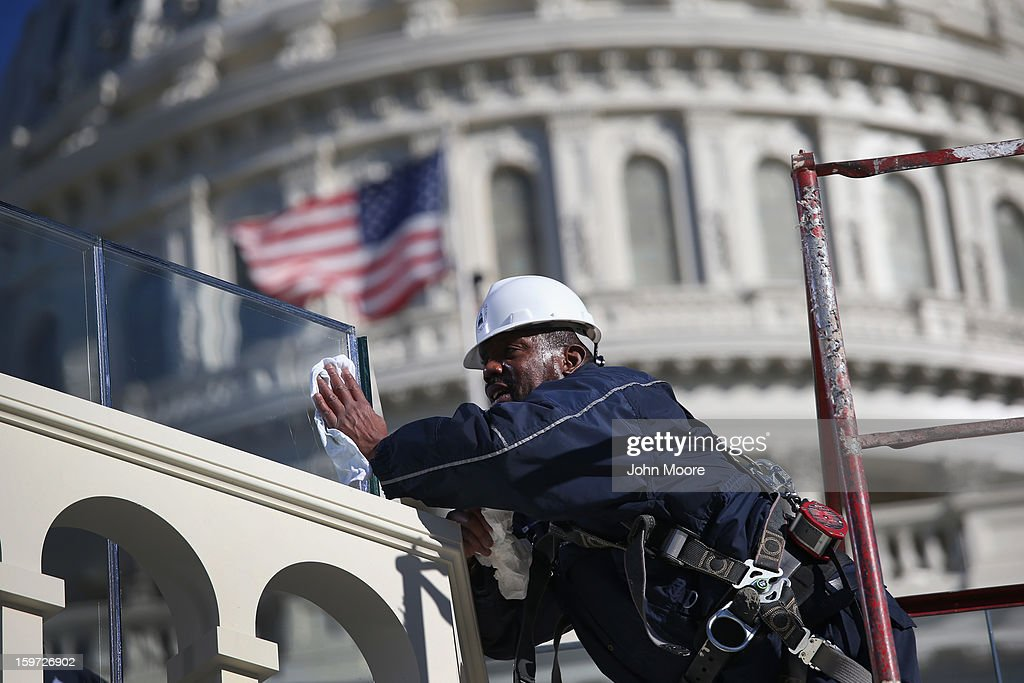 A worker cleans bulletproof glass on the west Capitol platform where President Barack Obama will take the oath of office during his second inauguration on January 19, 2013 in Washington, D.C. Preparations continued ahead of Monday's event, which is expected to draw more than half a million people.