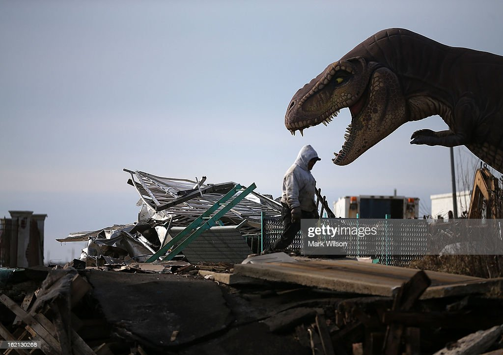 A worker cleans debris from the Fun Town Pier that was damaged by Superstorm Sandy, February 19, 2013 in Seaside Heights, New Jersey. Governor Chris Christie has estimated that damage in New Jersey caused by Superstorm Sandy could reach $37 billion. New Jersey.