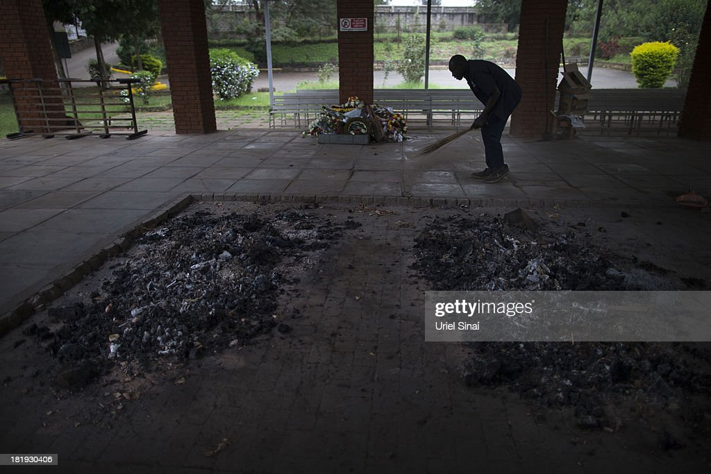 A worker cleans near the ashes of 2 of the victims from the Westgate Mall attack at a local crematorium a day after their funeral on September 26, 2013 in Nairobi, Kenya. The country is observing three days of national mourning as security forces begin the task of clearing and securing the Westgate shopping mall following a four-day siege by militants.