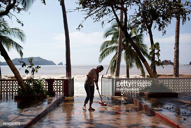 A worker cleans out the 'Monterey' Hotel after damage from Hurricane Patricia October 24 2015 in Melaque Jalisco Mexico Hurricane Patricia struck...
