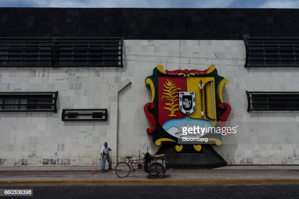 A worker cleans outside the Nayarit State Attorney Generals headquarters in Tepic Mexico on Wednesday March 29 2017 On Wednesday Nayarit Attorney...