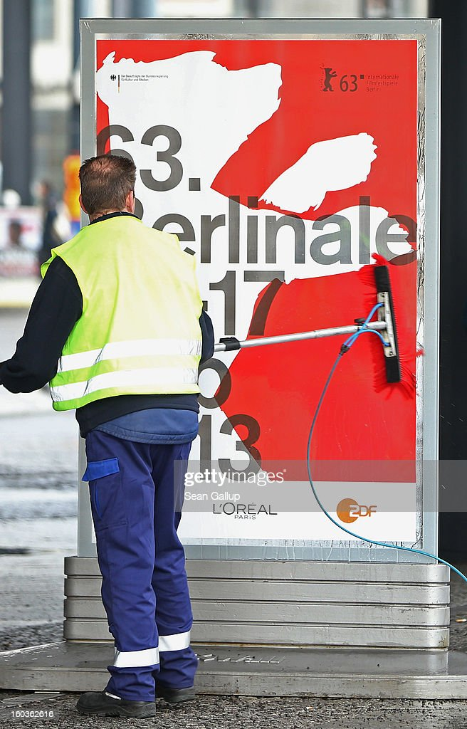 A worker cleans posters advertising the 63rd Berlinale International Film Festival on January 30, 2013 in Berlin, Germany. The 2013 Berlinale will run from February 7-17, 2013.