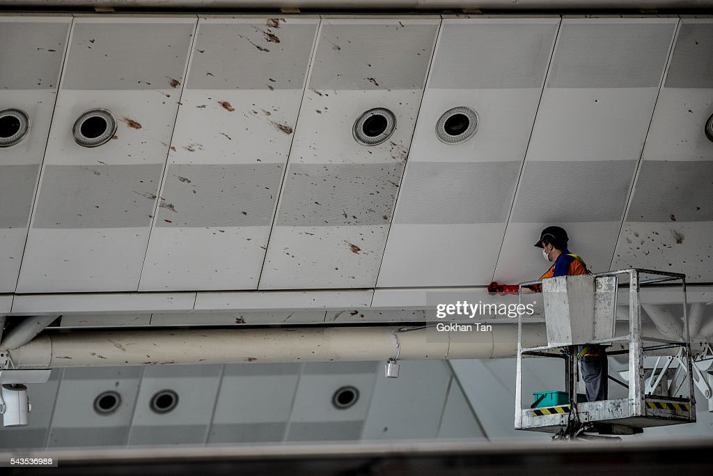 A worker cleans the blood splashed on the roof of the international departure terminal at the country's largest airport, Istanbul Ataturk following yesterday's blast on June 29, 2016 in Istanbul, Turkey. Three suicide bombers opened fire before blowing themselves up at the entrance to the main international airport in Istanbul yesterday. The Istanbul Governor's Office says 41 people have been killed, 37 of the victims have been identified, including 10 foreign nationals and three people with dual citizenship. More than 230 people were wounded but 109 have been discharged from hospitals in the deadly suicide bombing attack in Istanbul's Ataturk airport blamed on the Islamic State group.