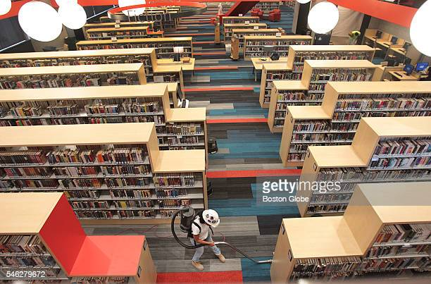 A worker cleans the carpet in the Fiction Section of the Boston Public Library on July 7 the day before the reopening of the library's newly...