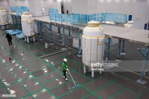 A worker cleans the floor in a bioreactor hall at the under construction Plant 3 inside the Samsung BioLogics Co headquarters and production...