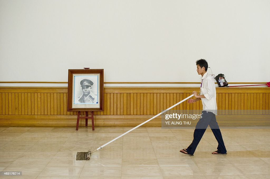 A worker cleans the floor next to a portrait of General <a gi-track='captionPersonalityLinkClicked' href=/galleries/search?phrase=Aung+San&family=editorial&specificpeople=812845 ng-click='$event.stopPropagation()'>Aung San</a> inside the parliment in NayPyiDaw on February 11, 2015. Celebrations will mark a hundred years since the birth of <a gi-track='captionPersonalityLinkClicked' href=/galleries/search?phrase=Aung+San&family=editorial&specificpeople=812845 ng-click='$event.stopPropagation()'>Aung San</a>, on February 13, 1915, Myanmar's independence hero and father of opposition leader <a gi-track='captionPersonalityLinkClicked' href=/galleries/search?phrase=Aung+San&family=editorial&specificpeople=812845 ng-click='$event.stopPropagation()'>Aung San</a> Suu Kyi. General <a gi-track='captionPersonalityLinkClicked' href=/galleries/search?phrase=Aung+San&family=editorial&specificpeople=812845 ng-click='$event.stopPropagation()'>Aung San</a> and eight other leaders were assassinated on July 19, 1947 just one year before their cherished goal of independence from Britain was achieved.