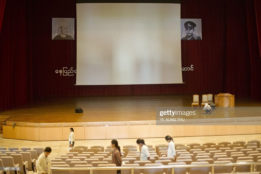 A worker (R) cleans the floor underneath a portrait of General <a gi-track='captionPersonalityLinkClicked' href=/galleries/search?phrase=Aung+San&family=editorial&specificpeople=812845 ng-click='$event.stopPropagation()'>Aung San</a> inside the parliment in NayPyiDaw on February 11, 2015. Celebrations will mark a hundred years since the birth of <a gi-track='captionPersonalityLinkClicked' href=/galleries/search?phrase=Aung+San&family=editorial&specificpeople=812845 ng-click='$event.stopPropagation()'>Aung San</a>, on February 13, 1915, Myanmar's independence hero and father of opposition leader <a gi-track='captionPersonalityLinkClicked' href=/galleries/search?phrase=Aung+San&family=editorial&specificpeople=812845 ng-click='$event.stopPropagation()'>Aung San</a> Suu Kyi. General <a gi-track='captionPersonalityLinkClicked' href=/galleries/search?phrase=Aung+San&family=editorial&specificpeople=812845 ng-click='$event.stopPropagation()'>Aung San</a> and eight other leaders were assassinated on July 19, 1947 just one year before their cherished goal of independence from Britain was achieved.