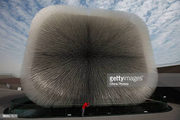 A worker cleans the glass at the UK Pavilion during the 2010 World Expo on May 7 2010 in Shanghai China The World Expo will be held from May 1...