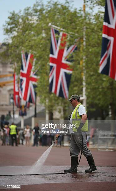 A worker cleans the road surface of The Mall on June 1 2012 in London England With two days to go before the start of Diamond Jubilee celebrations...