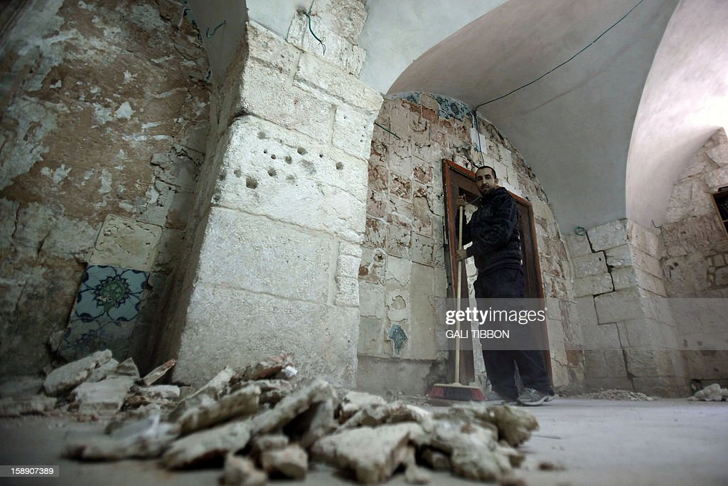 A worker cleans the rubble at King David's Tomb on Mount Zion in Jerusalem on January 3, 2013 after vandals smashed the 17th-century ceramic tiles decorating the Tomb. King David's Tomb is an ancient building sacred to the three monotheistic faiths. The lower part houses the traditional tomb of King David, while the Room of the Last Supper occupies the second floor, where according to Christian faith it is believed to be the site where Jesus celebrated Passover with his disciples before the crucifixion.