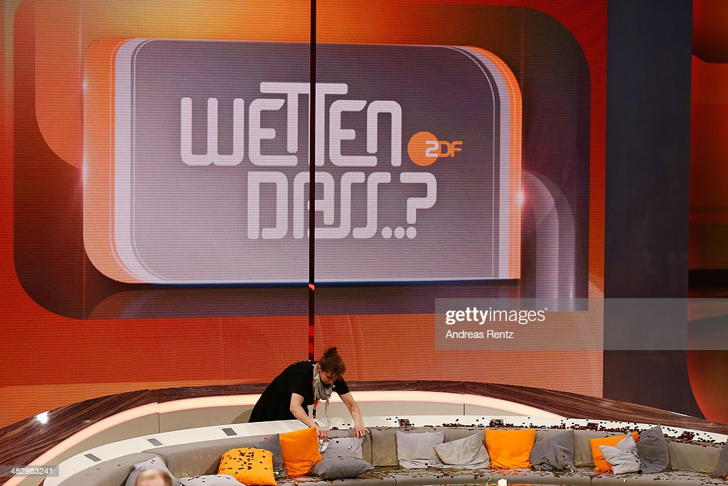 A worker cleans up the couch after the 'Wetten, dass..?' tv show on April 5, 2014 in Offenburg, Germany. The ZDF announced tonight the end of 'Wetten, dass..?'. The last show will held on December 6, 2014 in Nuremberg.