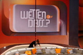 A worker cleans up the couch after the 'Wetten dass' tv show on April 5 2014 in Offenburg Germany The ZDF announced tonight the end of 'Wetten dass'...